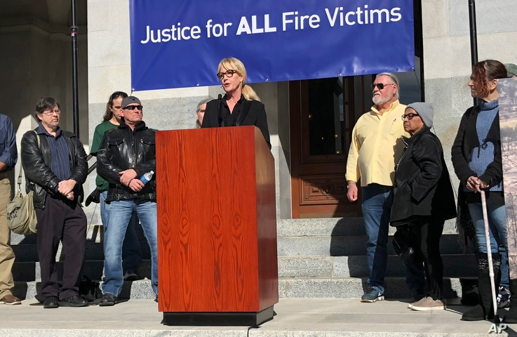 Consumer advocate Erin Brockovich, who famously took on Pacific Gas & Electric Co. in the 1990s, stands with wildfire victims and speaks outside the state Capitol in Sacramento, Calif., Jan. 22, 2019.