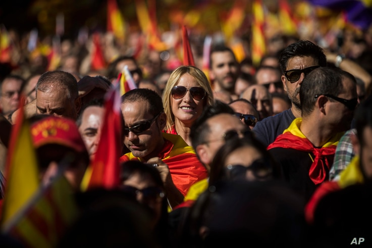 Activists march during a mass rally against Catalonia's declaration of independence, in Barcelona, Spain, Oct. 29, 2017.