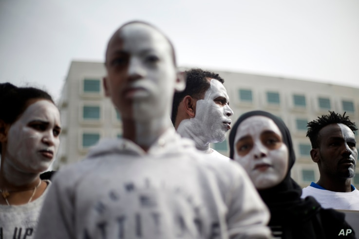 In this Wednesday, Feb. 7, 2018 photo, African migrants chant slogans during a protest in front of the Rwanda embassy in Herzeliya, Israel.