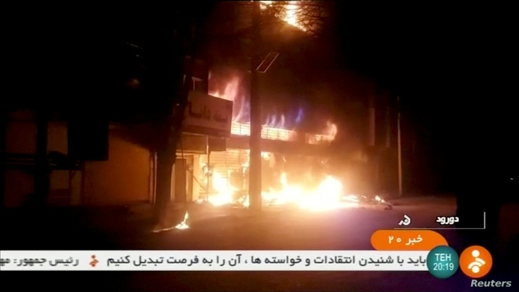 A building on fire is seen in Dorud, Iran, in this still image taken from video on Dec. 31, 2017.
