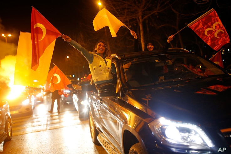 Supporters of President Recep Tayyip Erdogan celebrate in Istanbul, early Monday, April 1, 2019. Erdogan's ruling party has declared victory in the race for mayor of Istanbul, even though the result in Turkey's most populous city and commercial hub i...