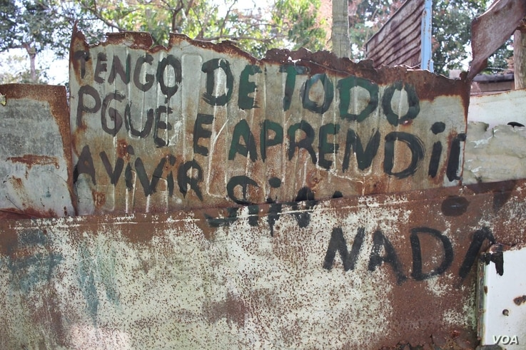 """I have everything, because I've learned to live without anything,"" reads a sign near Calabazar, on the outskirts of Havana, Cuba."