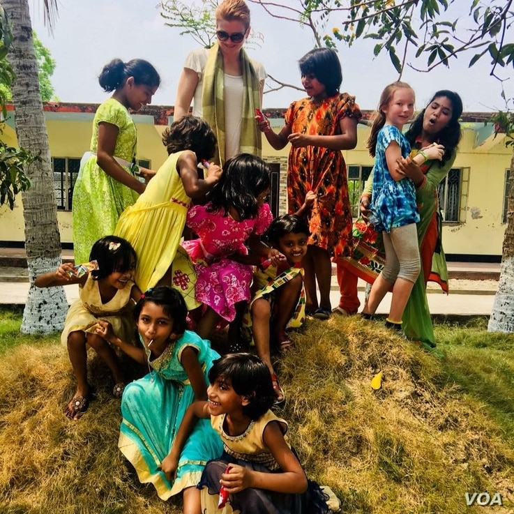 Mother and daughter Sasha and Maya Forbes teach English while playing with Bangladeshi girls in Khulna, Bangladesh, April 2018. The girls are part of the Alingon Home, a safe place for more than 20 girls who have been removed from brothels.