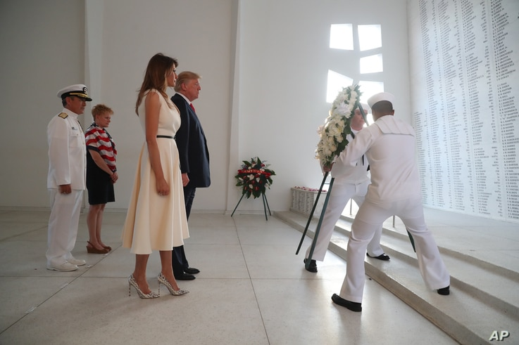 U.S. President Donald Trump and first lady Melania Trump lay a wreath at the USS Arizona Memorial in Pearl Harbor, Honolulu, Hawaii, Nov. 3, 2017. Trump begins a five-country trip through Asia traveling to Japan, South Korea, China, Vietnam and the ...