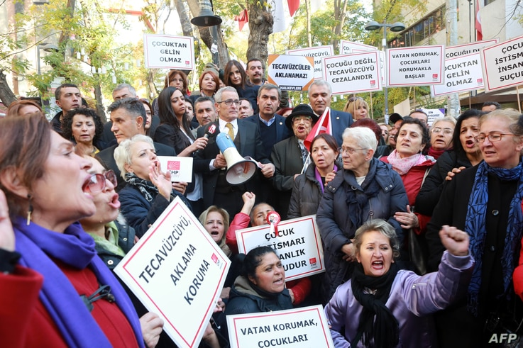 FILE - Turkish women stage a protest in Ankara on Nov. 19, 2016 after a government legislation proposal that would overturn men's convictions for child sex assault if they married their victim.
