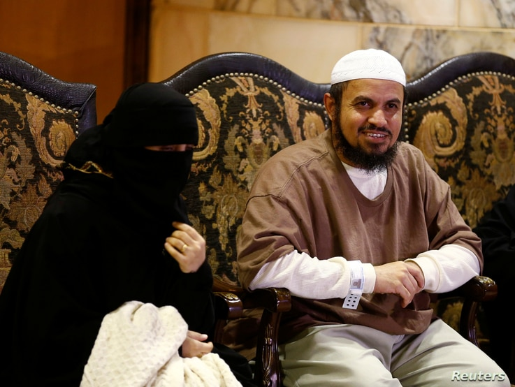 A released Yemeni detainee sits next to a family member after his arrival in Riyadh, Saudi Arabia, Jan. 5, 2017.