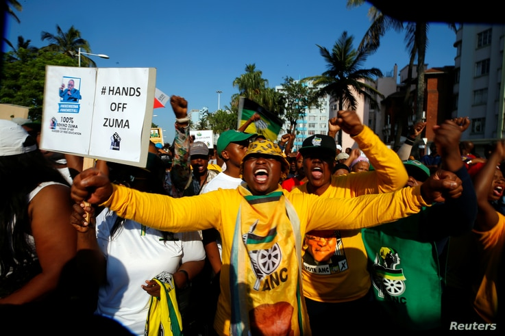Supporters of former South African president Jacob Zuma wait outside the high court in Durban, South Africa, April 6, 2018.