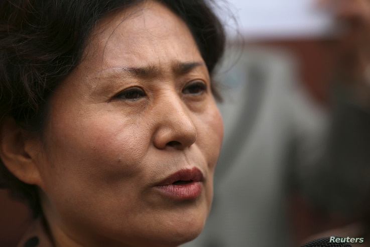 Geng He, wife of Gao Zhisheng, speaks at a news conference at the Chinese Consulate in San Francisco, California, August 7, 2014.