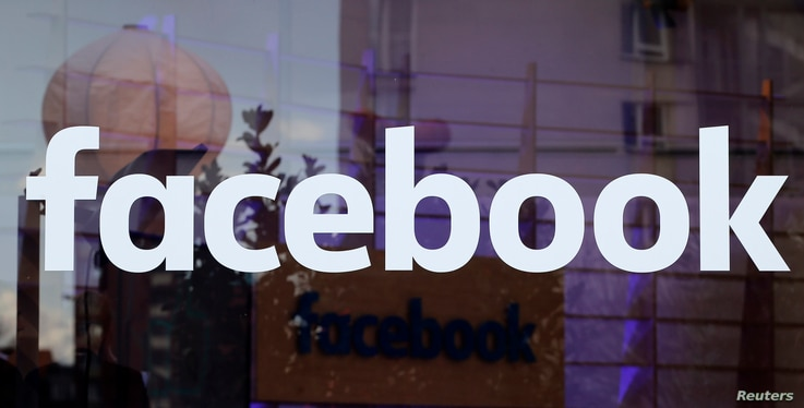 The logo of Facebook is pictured on a window at new Facebook Innovation Hub during a media tour in Berlin, Germany, Feb. 24, 2016.