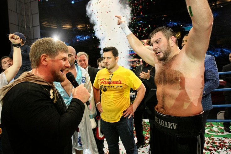 """Chechen leader Ramzan Kadyrov, left, congratulates Uzbekistan's  """"White Tyson"""" Ruslan Chagaev, right, while celebrating his victory over American Fres Oquendo after their WBA heavyweight boxing championship fight at Ahmat Arena, in Grozny, Russia."""