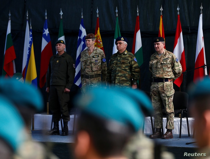 From left, Anton Waldner, new major general of European Forces; Adrian Bradshaw, general of European Forces; Mikhail Kostarakos, chairman of the European Union Military Committee; and James Rupert Everard, general of European Forces, attend a EUFOR c...