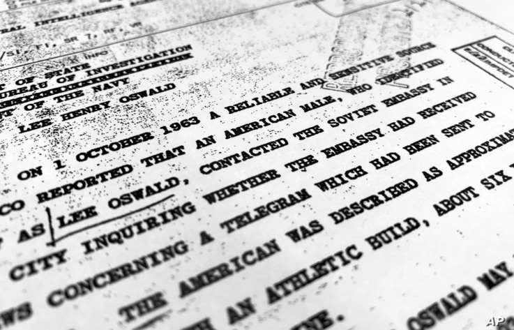 """FILE - Part of a file from the CIA, dated Oct. 10, 1963, details """"a reliable and sensitive source in Mexico"""" report of Lee Harvey Oswald's contact with the Soviet Union embassy in Mexico City, that was released for the first time on Nov. 3, 2017."""