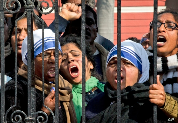 FILE - Indian Christians shout slogans protesting against recent attacks on churches in the Indian capital as they assemble outside the Sacred Heart Church in New Delhi, India, Thursday, Feb. 5, 2015.