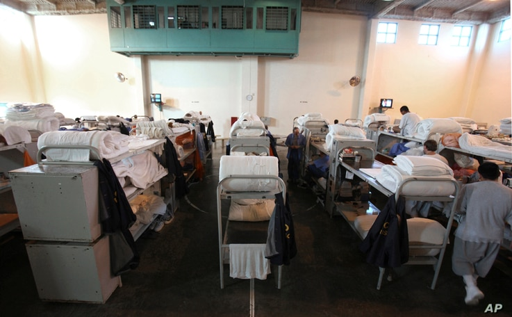 FILE - In this Jan. 14, 2009 file photo, triple-tier bunks are seen in a gymnasium converted to house prisoners at the California Substance Abuse Treatment Facility and State Prison in Corcoran,  Calif.