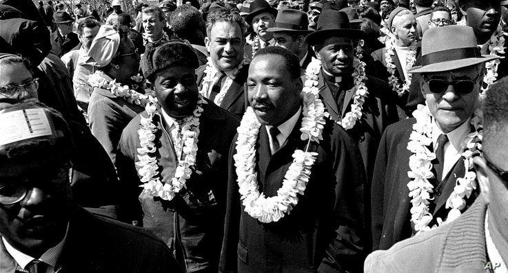 Martin Luther King, Jr. and his civil rights marchers cross the Edmund Pettus Bridge in Selma, Alabama, March 21, 1965.