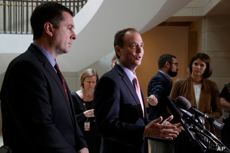 House Intelligence Committee Chairman Rep. Devin Nunes, listens at left, as the committee's ranking member Rep. Adam Schiff, D-Calif., talk to reporters on Capitol Hill, March 2, 2017.