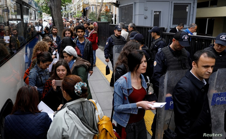 People wait in line to submit their personal appeals to the High Electoral Board for annulment of the referendum, in Ankara, Turkey, April 18, 2017.