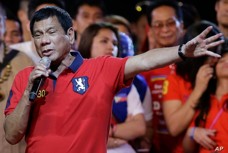 Philippine presidential race front-runner Davao city mayor Rodrigo Duterte gestures during his final campaign rally in Manila, Philippines, May 7, 2016.