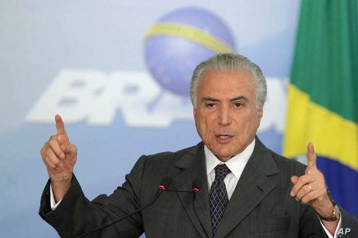 President Michel Temer speaks during a ceremony at the Planalto Presidential Palace, in Brasilia, Brazil, Tuesday, Dec. 13, 2016.  Earlier Tuesday, Brazil's Congress passed a measure to cap government spending over the next 20 years.
