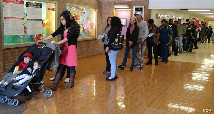 People wait in line to vote in Virginia, outside Washington D.C., Nov. 8, 2016. (Photo: D. Block / VOA)