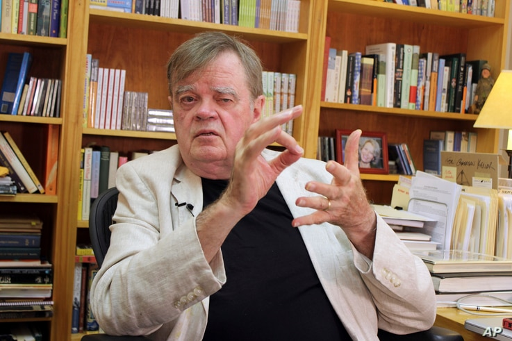 FILE - Garrison Keillor talks at his office in St. Paul, Minnesota, July 26, 2017.