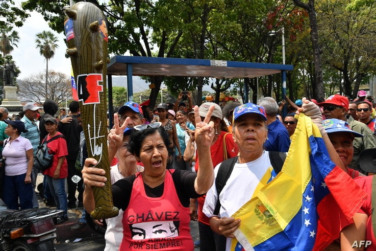 """Supporters of Venezuelan President Nicolas Maduro take part in a pro-government """"Anti-Imperialist March"""" in Caracas, March 30, 2019."""