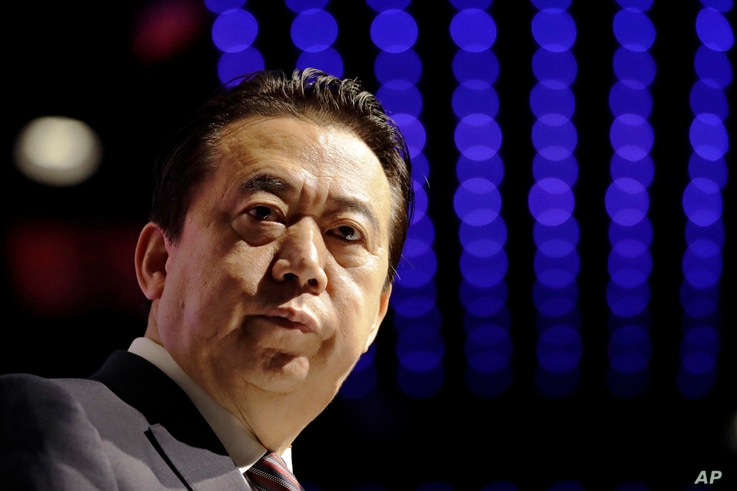 FILE - In this July 4, 2017, photo, Interpol President Meng Hongwei delivers his opening address at the Interpol world congress in Singapore.