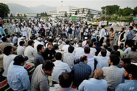 Pakistani journalists hold a protest rally and sit-in-protest outside the Parliament to condemn the killing of their colleague, Syed Salim Shahzad, this week after he reported being threatened by intelligence agents, in Islamabad, Pakistan, June 15, ...