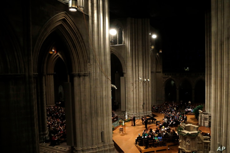 Candles are lit during a vigil for victims of the shooting at Sandy Hook Elementary School in Newtown, Conn. and other victims of gun violence at the National Vigil for Victims of Gun Violence at the National Cathedral in Washington, Thursday, Dec. 1...