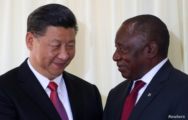 China's President Xi Jinping talks with South African President Cyril Ramaphosa after their media conference in Pretoria, South Africa, July 24, 2018.