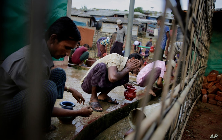 Rohingya refugees perform ablution before offering Eid al-Adha prayers at Kutupalong refugee camp, Bangladesh, Aug. 22, 2018.