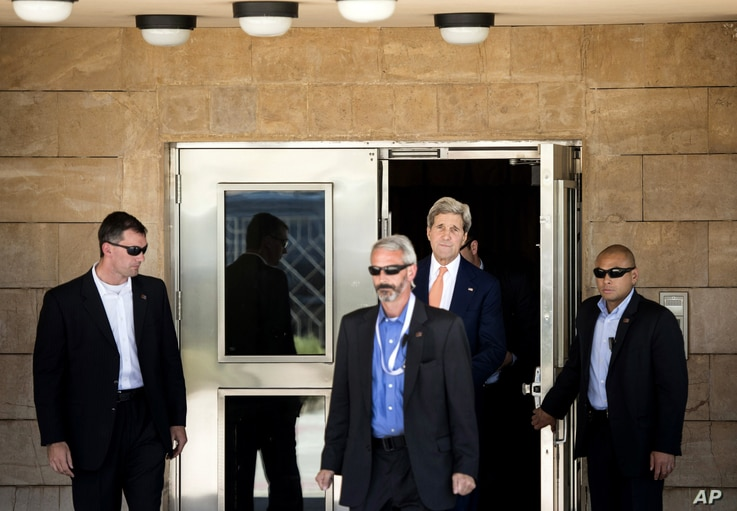 U.S. Secretary of State John Kerry leaves the U.S. embassy ahead of a meeting with Iraqi Prime Minister Nouri al-Maliki at his office in Baghdad, June 23, 2014.