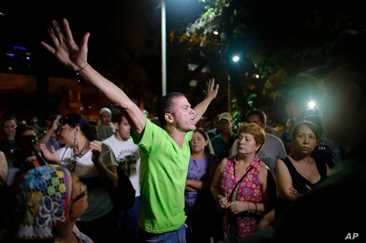 Opposition supporters celebrates the closing of a polling station during congressional elections in Caracas, Venezuela, Sunday, Dec. 6, 2015.
