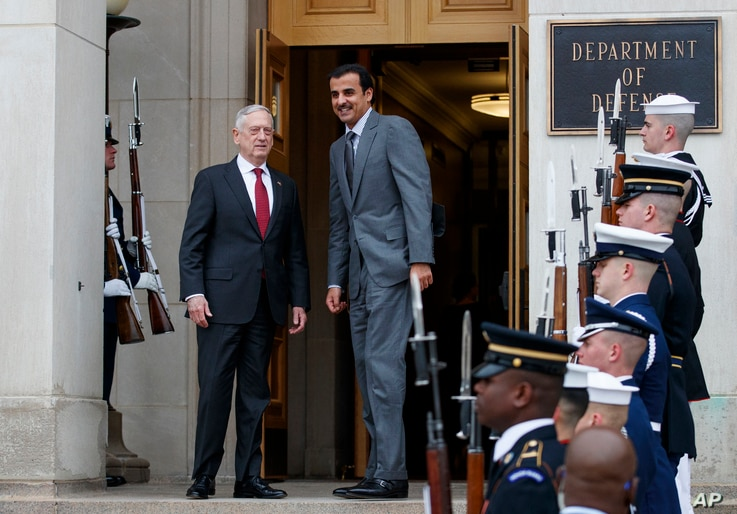 Defense Secretary Jim Mattis, left, stands with Emir of Qatar Sheikh Tamim bin Hamad al-Thani during an Honor Cordon at the Pentagon, April 9, 2018.