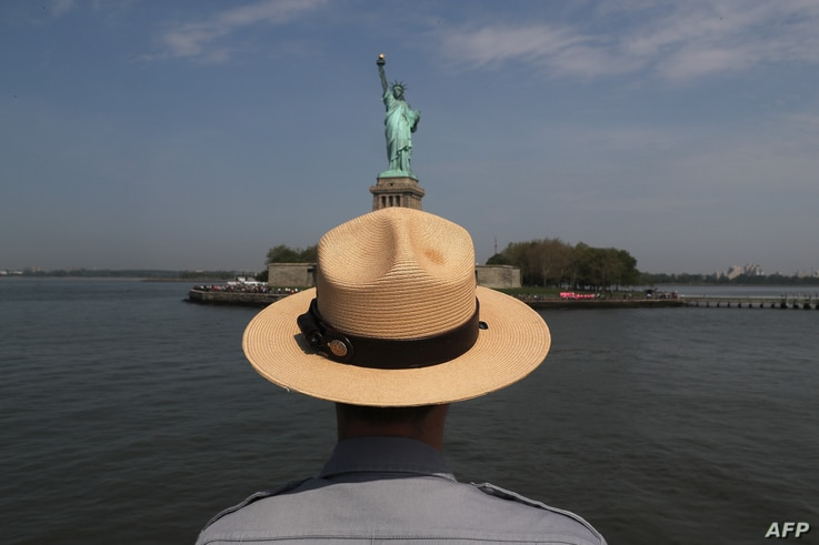 A U.S. park ranger looks towards the Statue of Liberty while in route to Ellis Island on May 27, 2016 in New York City. U.S. Secretary of Homeland Security Jeh Johnson visited the historic island to administer the oath of citizenship to immigrants fr...
