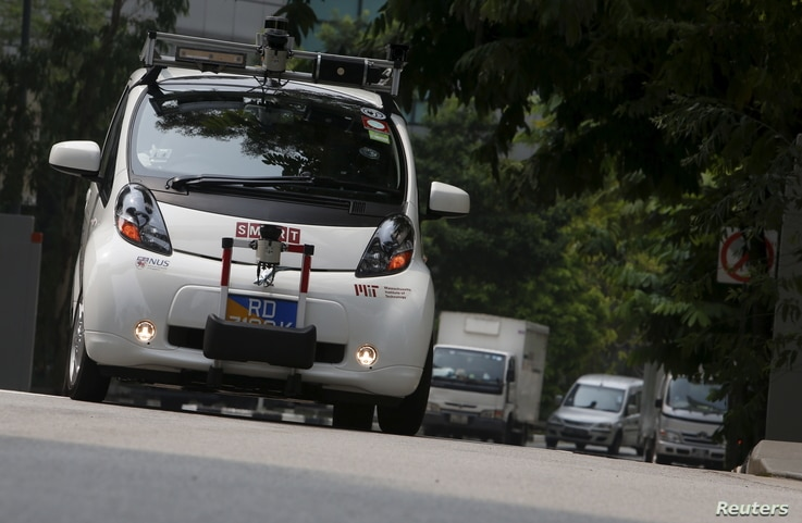 An autonomous self-driving vehicle goes onto the road during a demonstration at one-north business park in Singapore October 12, 2015.