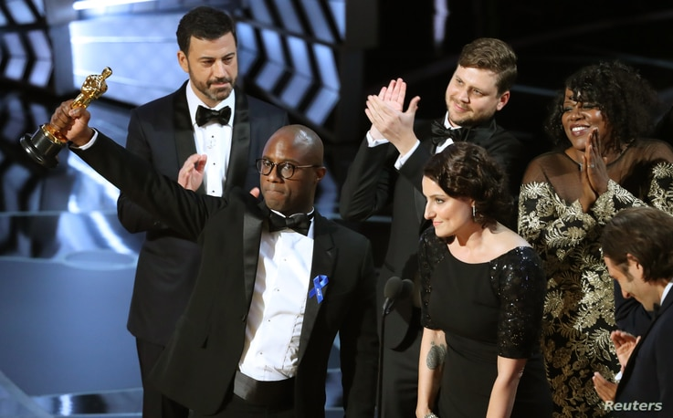 """Writer and Director Barry Jenkins of """"Moonlight"""" holds up the Best Picture Oscar."""