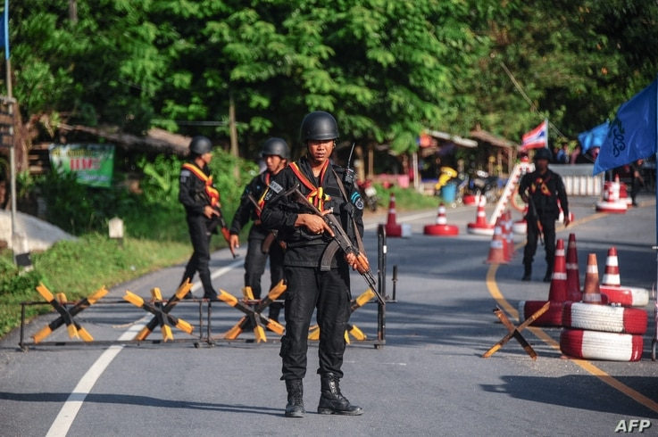 Thai Rangers at a checkpoint where a Thai army vehicle carrying six rangers was ambushed by suspected separatist militants in the Cha nea district in Thailand's restive southern province of Narathiwat on April 27, 2017.