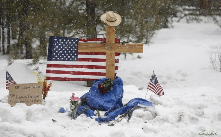 """A memorial for Robert """"LaVoy"""" Finicum is seen where he was shot and killed by law enforcement on a highway north of Burns, Ore., January 30, 2016."""