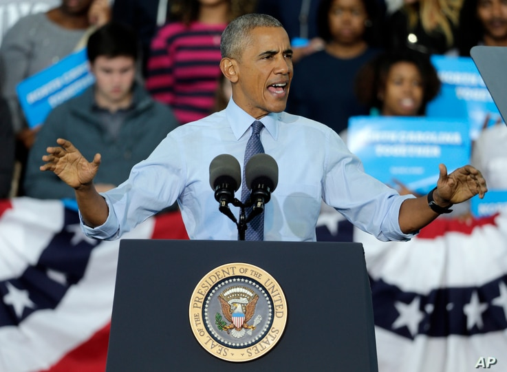 President Barack Obama speaks during a campaign rally for Democratic presidential candidate Hillary Clinton in Greensboro, N.C.,  Oct. 11, 2016.