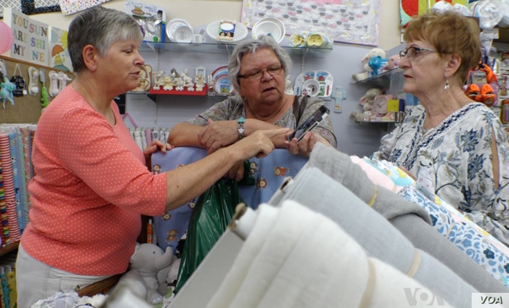 """Mary Lee Nielson, owner of the Quilted Ceiling in Valley City, North Dakota, and co-owner of a family farm, said because of U.S.-China tariffs, """"It's a very scary situation right now. ... I can see where a lot of farmers don't want to spend their mon..."""