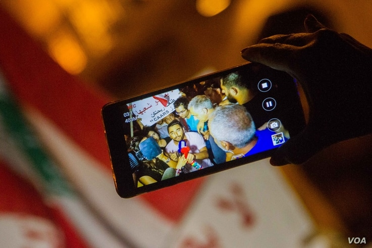 """The """"You Stink"""" movement and activists used mobile phones to document the protests against the country's rubbish crisis and subsequent police brutality, with footage often picked up by mainstream media. (John Owens for VOA)"""