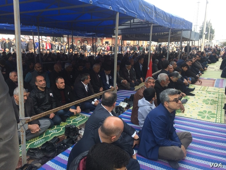 Mourners gather at a funeral for a Turkish soldier killed in the Afrin conflict.  Soldiers and civilians on both sides have died. Pictured on Feb. 4, 2018.