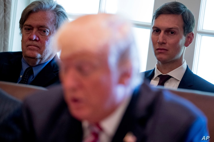 White House Senior Advisers Steve Bannon, left, and Jared Kushner, listen as President Donald Trump speaks during a Cabinet meeting, June 12, 2017, in the Cabinet Room of the White House in Washington.