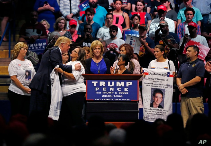 Republican presidential candidate Donald Trump kisses mothers from the Remembrance Project, who have lost sons to violence by illegal immigrants, as he speaks at a campaign rally in Austin, Texas, Aug. 23, 2016.