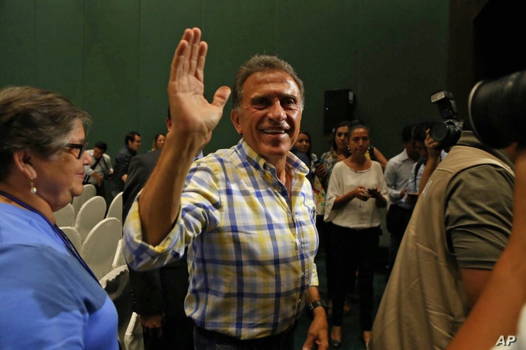 FILE - Miguel Angel Yunes waves at supporters as he arrives to a news conference in Veracruz, Mexico, on June 5, 2016. Hobbled by corruption scandals, violence and a weak economy, the ruling Institutional Revolutionary Party lost four states includin...