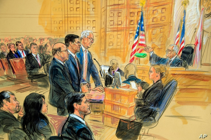 This courtroom sketch depicts former President Donald Trump's former national security adviser Michael Flynn, standing (C), flanked by his lawyers, listening to U.S. District Judge Emmet Sullivan (R) as he addresses Flynn and points to the American f...