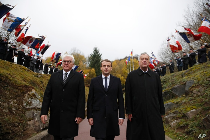 "FILE - French President Emmanuel Macron, center, and German President Frank-Walter Steinmeier left, attend a WWI ceremony at the World War I Vieil Armand ""Hartmannswillerkopf"" battlefield in the Alsace region, eastern France, where around 30,000 Fren..."