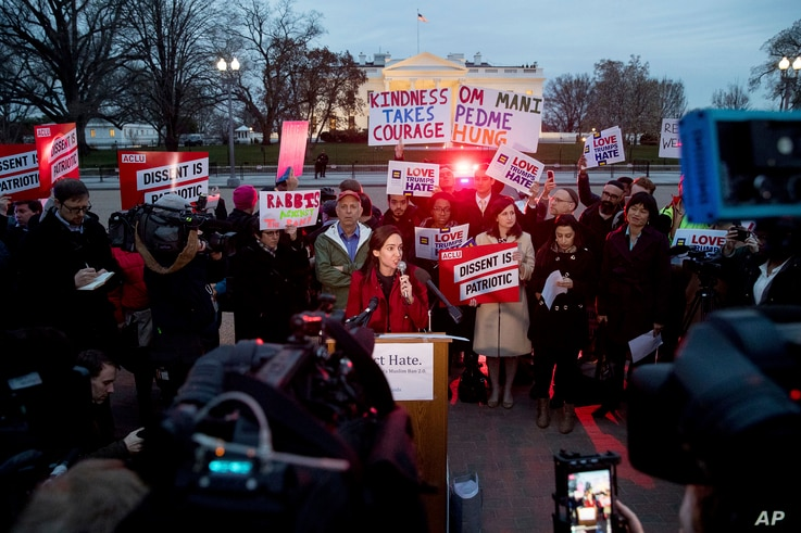 People gather to protest President Trump's new travel ban order in Lafayette Park outside the White House, March 6, 2017.