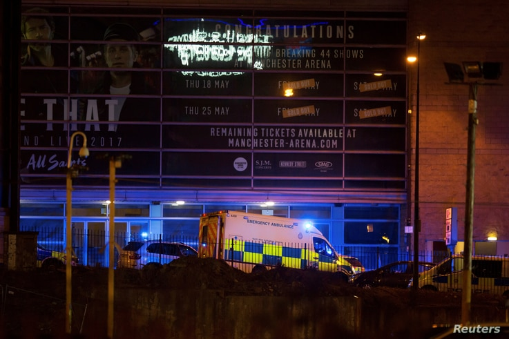 A police van and an ambulance are seen outside the Manchester Arena, where U.S. singer Ariana Grande had been performing, in Manchester, northern England, Britain May 22, 2017.
